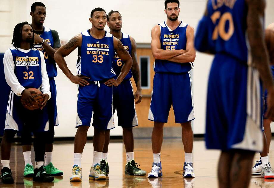 Summer league roster players Kiwi Gardner, (32) Roderick Odom,(50) Orlando Johnson,(33) Rodney McGruder, (6) and Mitchell Watt, (55) listen to instructions during workouts as the Golden State Warriors hold a practice session at Sierra Vista High school on Thursday July 10, 2014, in Las Vegas, Nv., as the NBA Summer League games get underway. Photo: Michael Macor / The Chronicle