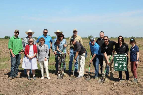 Representatives from Katy Prairie Conservancy, Newfield Foundation and Ducks Unlimited participate in a groundbreaking on a wetlands restoration project. The project will create nearly 45 acres of wetlands on Katy Prairie Conservancy's land in Waller County.