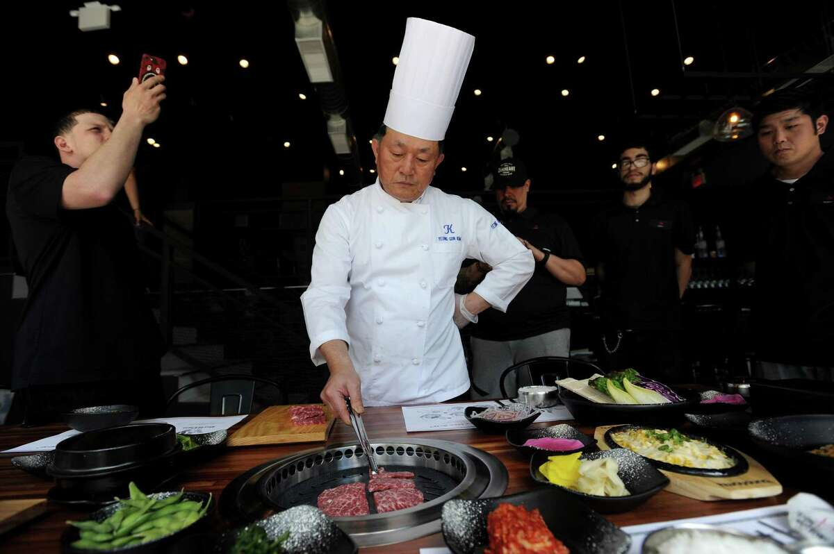Chef Kim Yeong Gon cooks wagu beef during a tabletop demonstration inside the Bull Pan Korean BBQ at 485 Summer St., in downtown Stamford, Conn., on Monday, May 7, 2018.