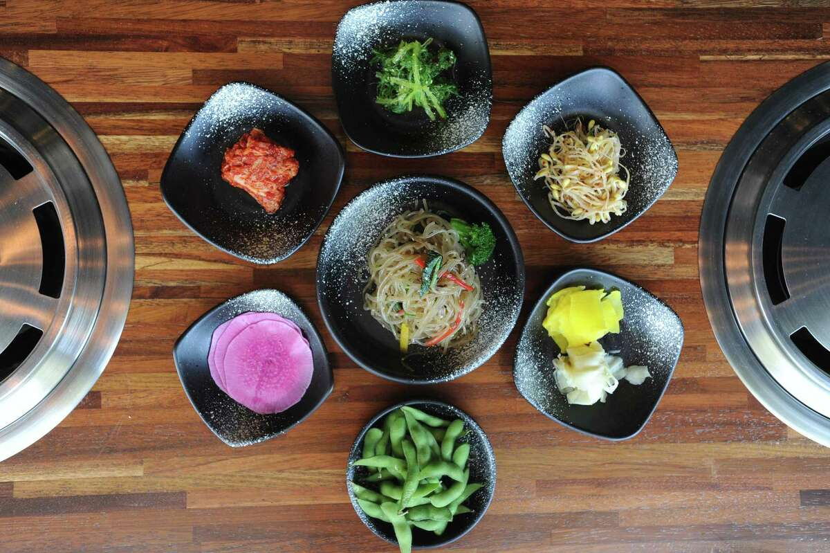 Noodle appetizer japchae is displayed with side dishes inside the new Bull Pan Korean BBQ at 485 Summer St., in downtown Stamford, Conn., on Monday, May 7, 2018.