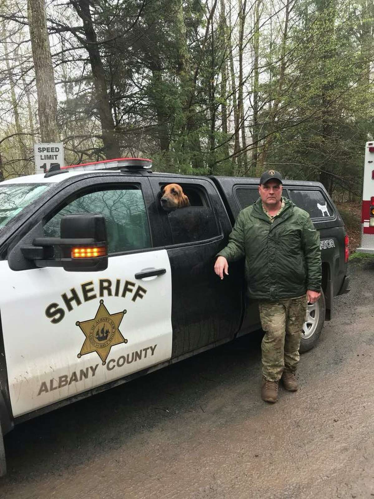 Albany County Fire Coordinator Gerald Paris, left, and Albany County Sheriff's search dog Baxter, a bloodhound, help forest rangers search for a missing 73-year-old man missing in Hunter, Greene County on Saturday, May 12, 2018. He was found and treated for hypothermia.