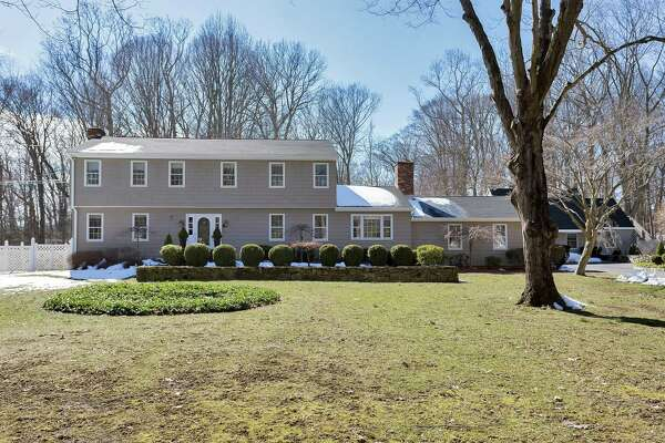The gray shingle Garrison colonial house at 2745 Burr Street sits on a two-acre property and is close enough to the Connecticut Audubon Society on Burr Street to enjoy its acreage and assets.