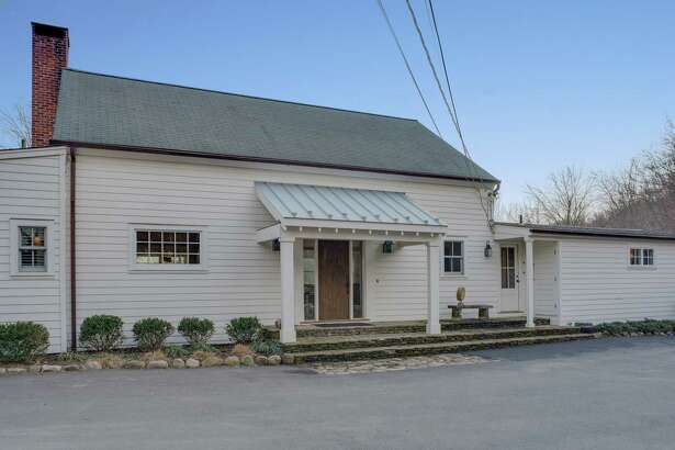 The white antique converted barn at 579 Ridgefield Road has eight rooms, 2,797 square feet of living space and it offers one-level living.