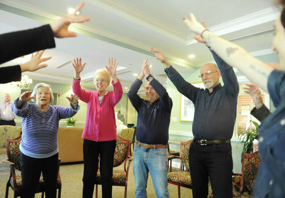 Residents, from left, Loulette Jordi, Carol Shultz, Peter Schwartz and Bob Fischel dance along to music during the creative arts therapy program at The Greens at Greenwich in Greenwich, Conn. Monday, May 14, 2018. More than 30 residents are enrolled in the program, which aims to circumvent the effects of dementia and stroke by opening up a new form of communication through music and art.