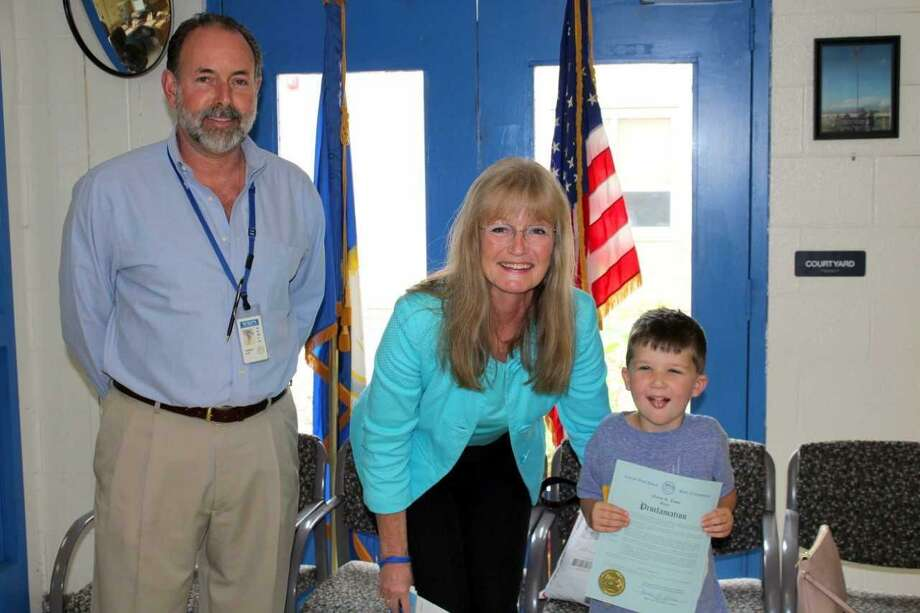West Haven Mayor Nancy Rossi presents Forest Elementary School kindergartner Nicholas Gorske, right, a proclamation declaring Apraxia Awareness Day in West Haven. At left is school Principal Thomas J. Hunt. Photo: Contributed / Michael P. Walsh - City Of West Haven /