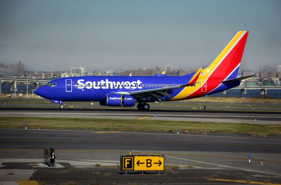 Some passengers on a Southwest Airlines flight from Denver suffered minor injuries when the plane appeared to suddenly lose cabin pressure as it neared Dallas. Photo: Robert Alexander/Getty Images