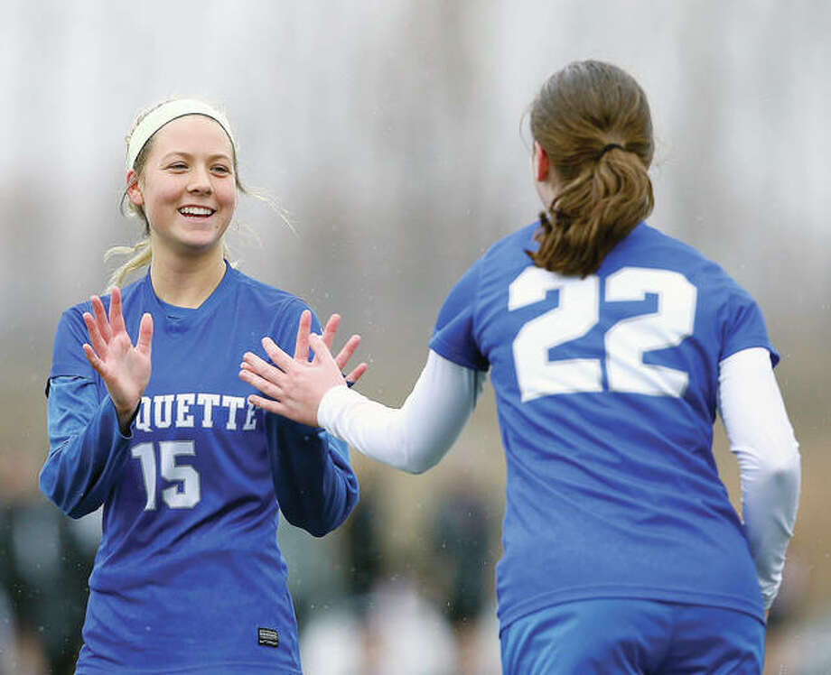 Marquette's Kaya Thies (15) is congratulated by Kelsey Eisenbeis (22) during a victory earlier this season. Teies, a sophomore, has 10 goals and eight assists this season for the Explorers, who will take on Belleville Althoff at 7 p.m. Tuesday in a semifinal of the Columbia Class 1A Sectional. Photo:       Billy Hurst File Photo | For The Telegraph