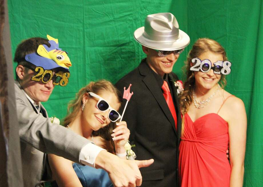 Elkton-Pigeon-Bay Port Laker prom attendees have a little fun while taking photos at the school's prom celebration Saturday. Photo: Coulter Mitchell/For The Tribune