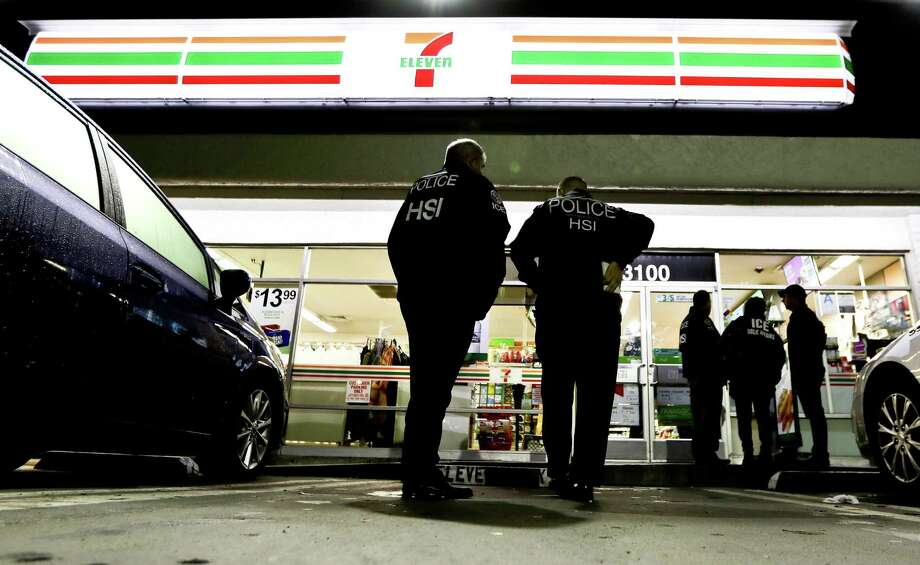 "In this Jan. 10, 2018, file photo U.S. Immigration and Customs Enforcement agents serve an employment audit notice at a 7-Eleven convenience store in Los Angeles. Immigration officials have sharply increased audits of companies to verify that their employees are authorized to work in the country, signaling the Trump administration's crackdown on illegal immigration is reaching deeper into the workplace to create a ""culture of compliance"" among employers who rely on immigrant labor. Photo: Chris Carlson /Associated Press / Copyright 2018 The Associated Press. All rights reserved."