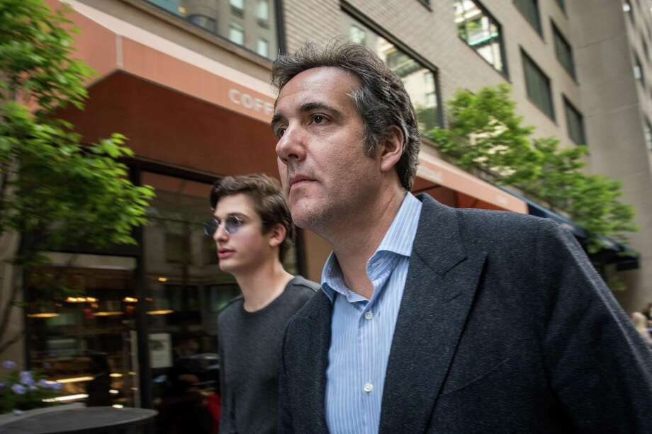 Michael Cohen, former personal attorney for U.S. President Donald Trump, walks with his children as he exits the Loews Regency Hotel, May 11 in New York City. AT&T CEO Randall Stephenson said this week that it was a mistake to hire Cohen as a consultant it was revealed they paid him $600,000 last year. Photo: Drew Angerer /Getty Images / 2018 Getty Images