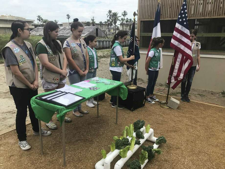 In this undated photo, members of Girl Scouts organized and staged a dedication ceremony at the Amos Rehabilitation Keep as part of their Silver Award project in Port Aransas, Texas. The Girl Scouts builds women leaders. Photo: David Sikes /Associated Press / Corpus Christi Caller-Times