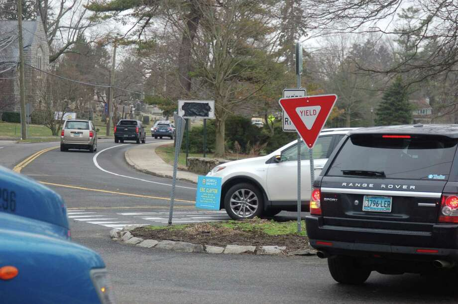 The heavily used traffic circle on Sound Beach Avenue in Old Greenwich could be turned into more of a traditional roundabout as part of a project to replace a bridge there and raise the level of the road. Photo: Ken Borsuk /
