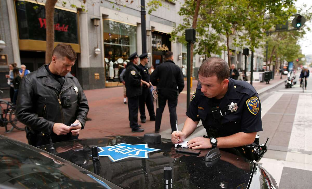 San Francisco police officers Cornyn, (left) and Alioto, work a traffic incident along Market St. in San Francisco, Ca. on Mon. May 14, 2018.