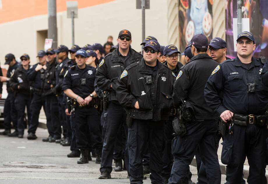 Lines of SFPD officers stand by during the March For Our Lives rally held in support of gun control and youth activism Saturday, March 24, 2018 in San Francisco, Calif. Photo: Jessica Christian / The Chronicle