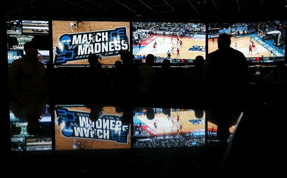 People watch March's NCAA basketball tournament at the Westgate Superbook in Las Vegas. Nevada is one of four states with legal sports gambling. Photo: John Locher / Associated Press
