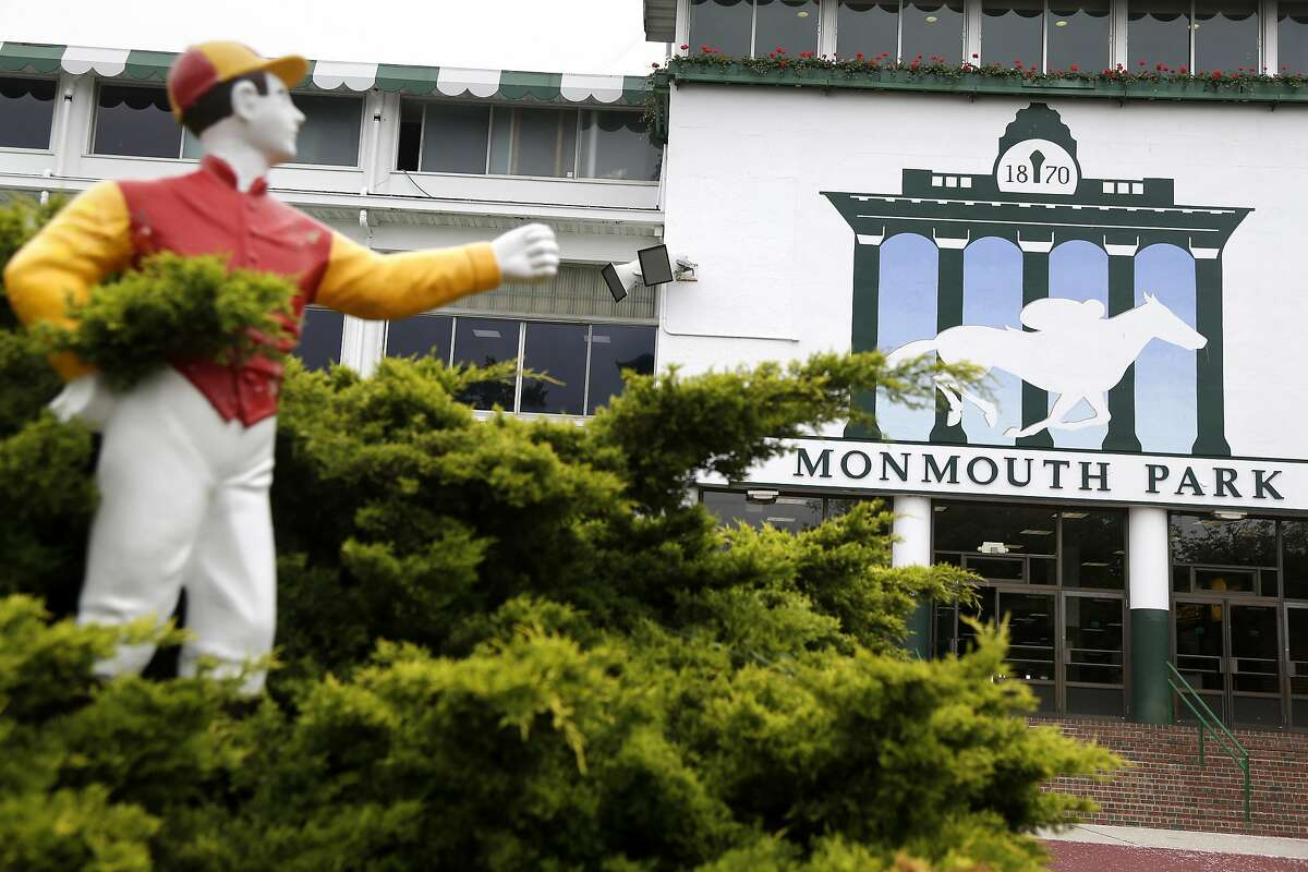 A statue of a jockey stands at the entrance to Monmouth Park in Oceanport, N.J., Monday, May 14, 2018. The Supreme Court on Monday gave its go-ahead for states to allow gambling on sports across the nation, striking down a federal law that barred betting on football, basketball, baseball and other sports in most states. Monmouth Park has already set up a sports book operation and has previously estimated it could take bets within two weeks of a favorable Supreme Court ruling. (AP Photo/Seth Wenig)