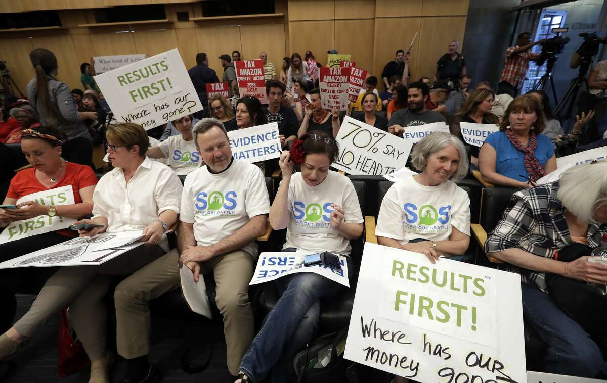 The raucous chambers of the Seattle City Council: Activists fill seats before a Seattle City Council meeting where the council was expected to vote on a