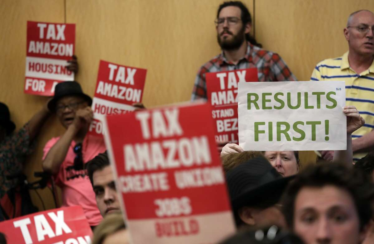 The scene last month as Seattle City Council members prepared to enact an employee head tax on the city's major employers. (AP Photo/Elaine Thompson)