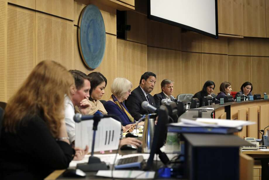 "File photo of city council members look on as members of the public speak at a Seattle City Council meeting where the council was expected to vote on a ""head tax"" Monday, May 14, 2018, in Seattle. The council is to vote on a proposal to tax large businesses such as Amazon and Starbucks to fight homelessness. The plan would tax large businesses about $500 a year per worker to raise about $75 million a year for homeless services and affordable housing. (AP Photo/Elaine Thompson) Photo: Elaine Thompson/AP"