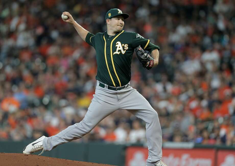Oakland Athletics starting pitcher Trevor Cahill (53) pitches against Houston Astros center fielder George Springer (4) in the first inning  on Sunday, April 29, 2018, in Houston. ( Elizabeth Conley / Houston Chronicle ) Photo: Elizabeth Conley, Houston Chronicle