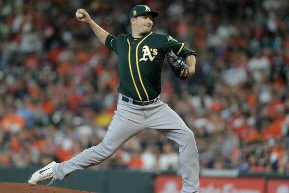 Oakland Athletics starting pitcher Trevor Cahill (53) pitches against Houston Astros center fielder George Springer (4) in the first inning  on Sunday, April 29, 2018, in Houston. ( Elizabeth Conley / Houston Chronicle )
