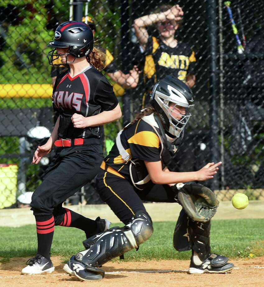 Sophia Vagts of Cheshire scores ahead of the throw to Amity catcher Rachael Crow in the fifth inning on Monday. Photo: Arnold Gold / Connecticut Hearst Media / New Haven Register