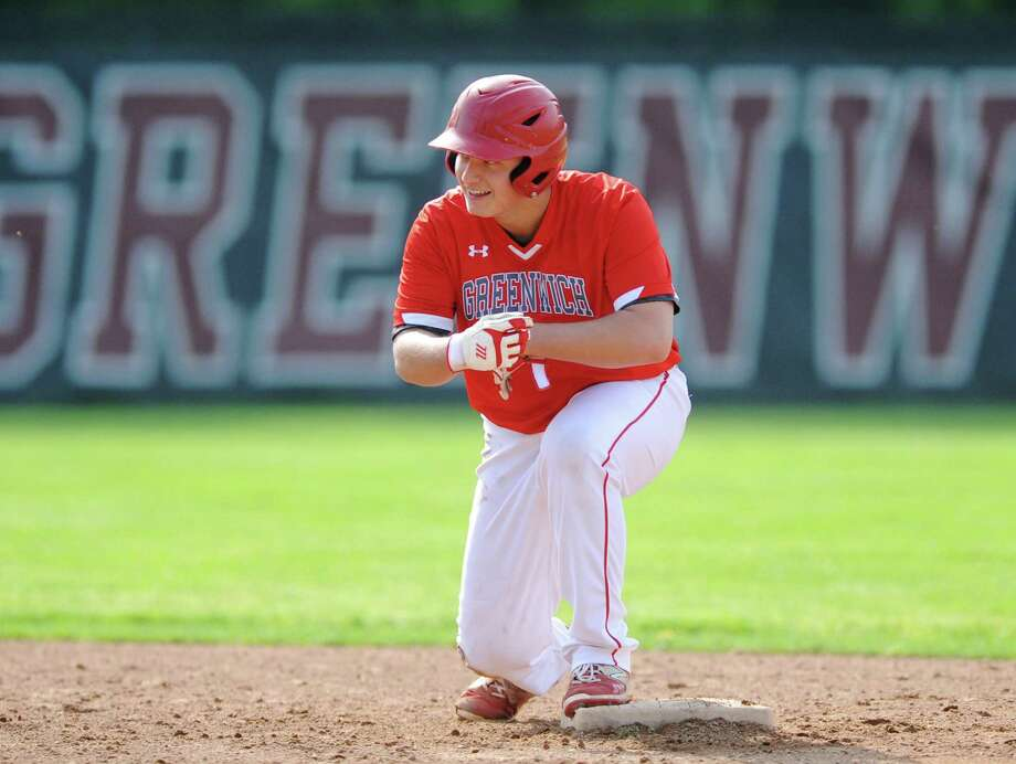 Greenwich designated hitter Charlie Povinelli celebrates an RBI double against Trinity Catholic on Monday in Greenwich. Photo: Tyler Sizemore / Hearst Connecticut Media / Greenwich Time