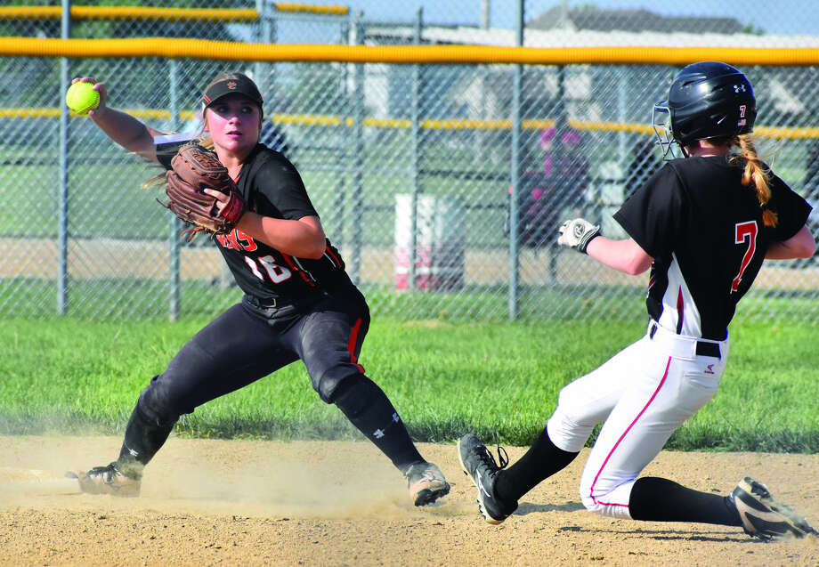 Edwardsville's Emma Lewis, left, forces out the runner at second and prepares to throw to first to try and complete a double play during Monday's non-conference game at Highland.