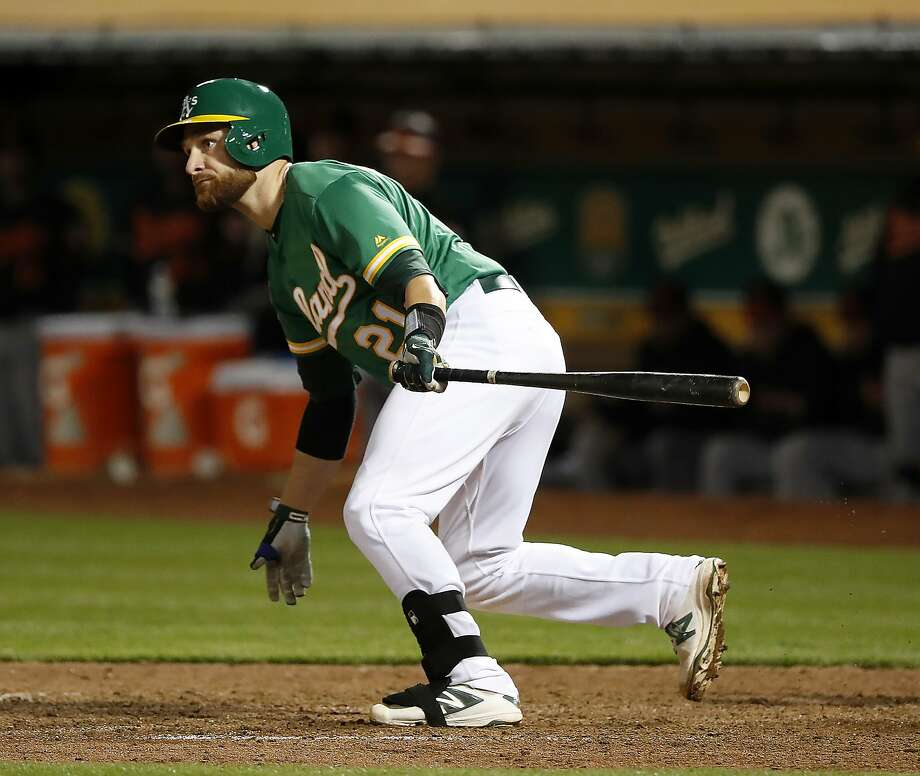 Oakland Athletics' Jonathan Lucroy hits a double against the Baltimore Orioles during the eighth inning of a baseball game Friday, May 4, 2018, in Oakland, Calif. Oakland won 6-4. (AP Photo/Tony Avelar) Photo: Tony Avelar / Associated Press