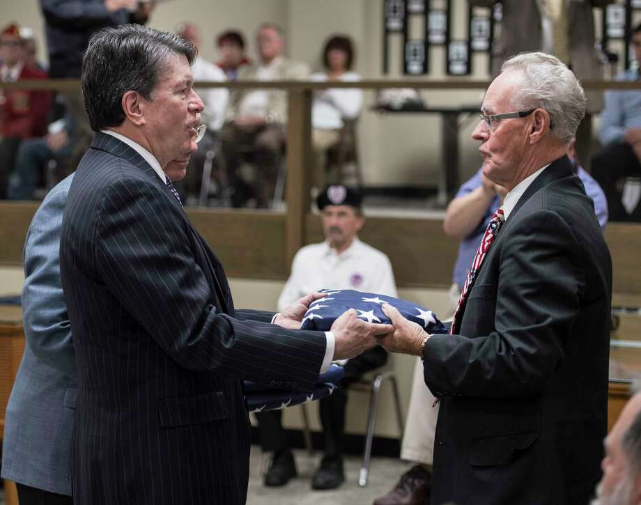 Congressmen John Faso and Paul Tonko present a flag that was flown over the Capitol in Washington DC to John Rustin in honor of his brothers during the Rensselaer County Honor-A-Decease Veteran ceremony held in the Rensselaer County Legislative Chambers Monday May 14, 2018 in Troy, N.Y. (Skip Dickstein/Times Union) Photo: SKIP DICKSTEIN / 20043767A