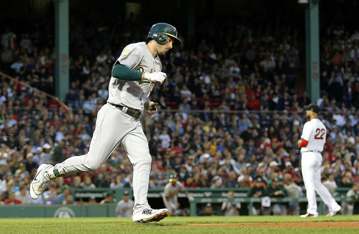 Oakland Athletics' Matt Joyce rounds the bases after hitting a solo home run off of Boston Red Sox starting pitcher Rick Porcello (22) during the third inning of a baseball game at Fenway Park in Boston Monday, May 14, 2018. (AP Photo/Winslow Townson)