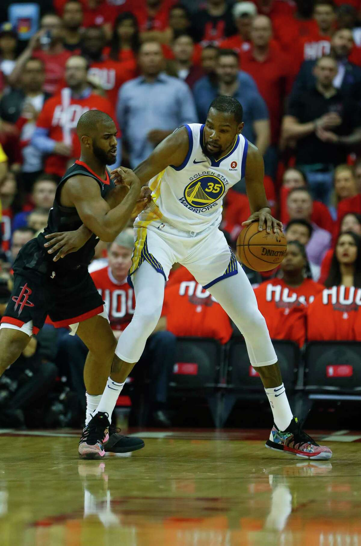 Houston Rockets guard Chris Paul (3) guards Golden State Warriors forward Kevin Durant (35) during the first half in Game 1 of the NBA Western Conference Finals at Toyota Center on Monday, May 14, 2018, in Houston.