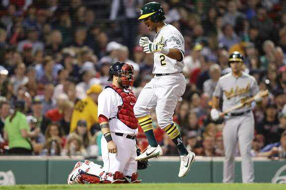 BOSTON, MA - MAY 14: Khris Davis #2 of the Oakland Athletics celebrates after hitting a home run against the Boston Red Sox during the eighth inning at Fenway Park on May 14, 2018 in Boston, Massachusetts. (Photo by Maddie Meyer/Getty Images)