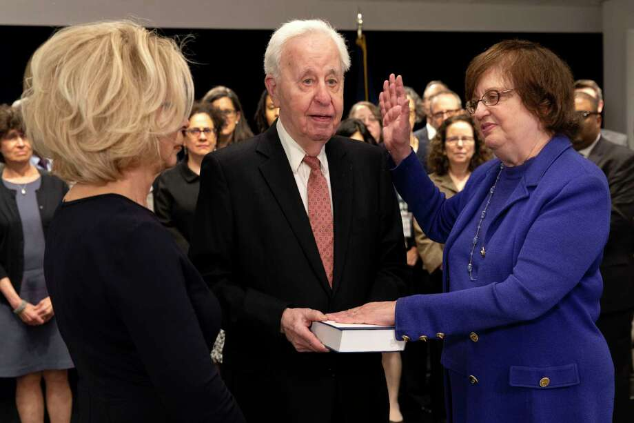 In this photo provided by the New York Attorney General's Office, Solicitor General Barbara Underwood, right, takes the oath of office at the State Capitol in Albany, N.Y., Tuesday, May 7, 2018. Underwood became the state's acting Attorney General after Eric Schneiderman resigned amid accusations of abusing four women during intimate encounters. From left is New York Chief Judge Janet DiFiore, Underwood's husband Martin Halpern and Barbara Underwood. (New York Attorney General's Office via AP) / New York Attorney General's Offi