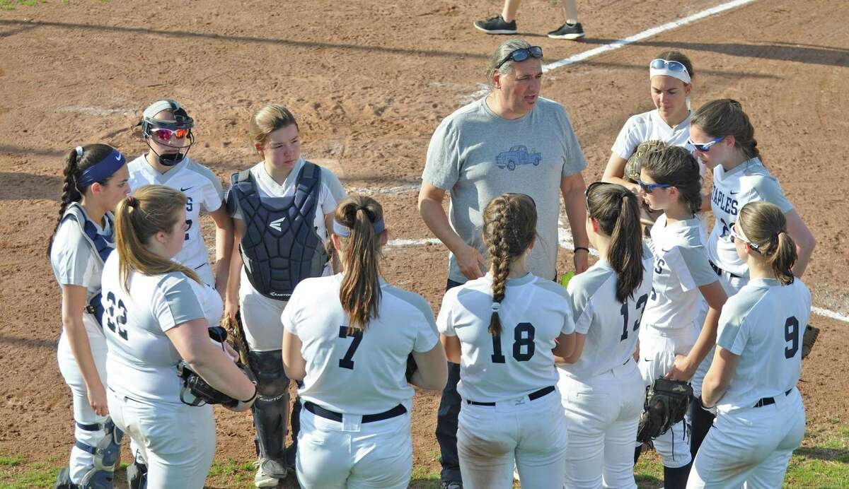 Staples High softball coach Luigi Cammarota talks to his team during a game earlier this season. Cammarota was suspended on Friday, one week after a confrontation with a parent led to a complaint against him.