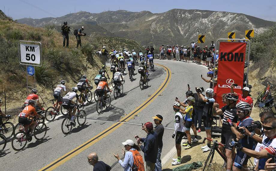 Riders sprint past the crowd during Stage 2 of the Tour of California race in Ventura County. Photo: Mark J. Terrill / Associated Press