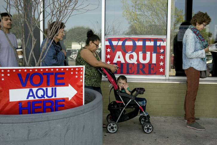 Marcelina Cavajal waits in line with her son, Anjelito Jaimes, 3, and other voters outside a polling station in Austin, Texas, March 1, 2016. Voters in 12 states go to the polls Tuesday as Donald Trump and Hillary Clinton, who have had the most success in the early nominating contests, look to extend their delegate leads over their nearest rivals. (Ilana Panich-Linsman/The New York Times)