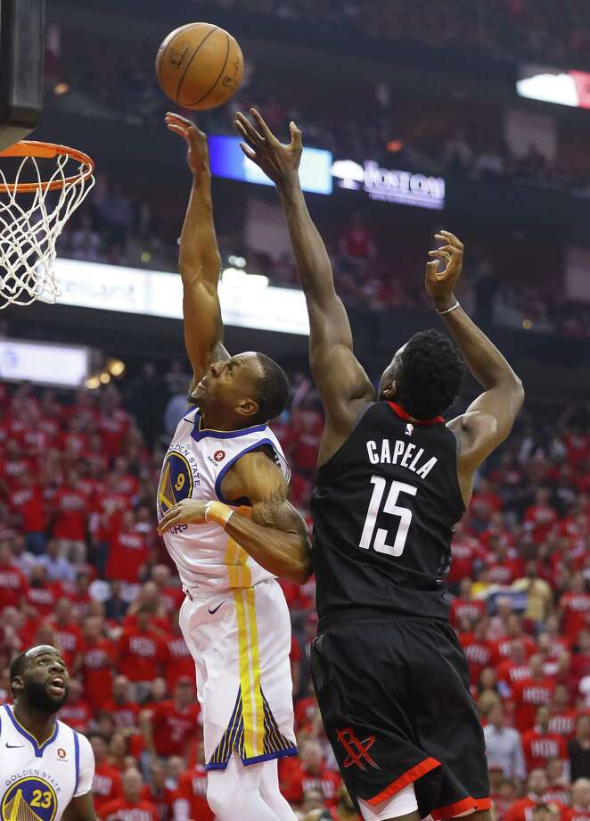 During Monday night's game, Iguodala and Rockets center Clint Capela, right, battle for a rebound. Rockets general manager Daryl Morey pursued the Warriors forward last offseason. Photo: Brett Coomer, Staff / Houston Chronicle / © 2018 Houston Chronicle