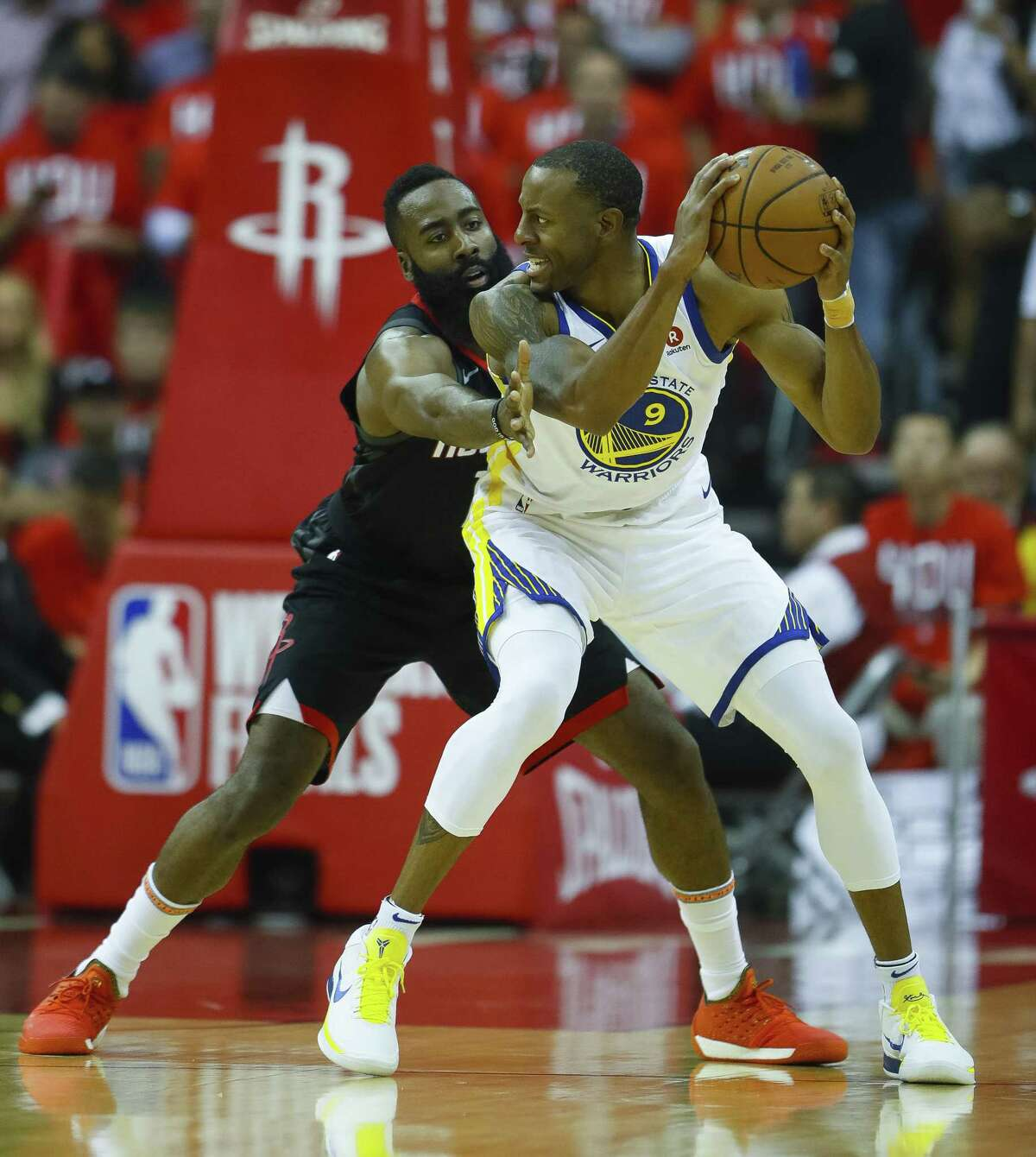 Rockets guard James Harden, left, defends Warriors forward Andre Iguodala on Monday night. There was a chance last summer they could have been teammates.