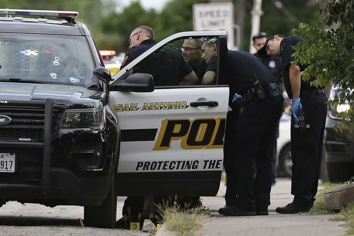 A longtime police officer fired through the windshield of his vehicle when the suspect began shooting at him, police said.