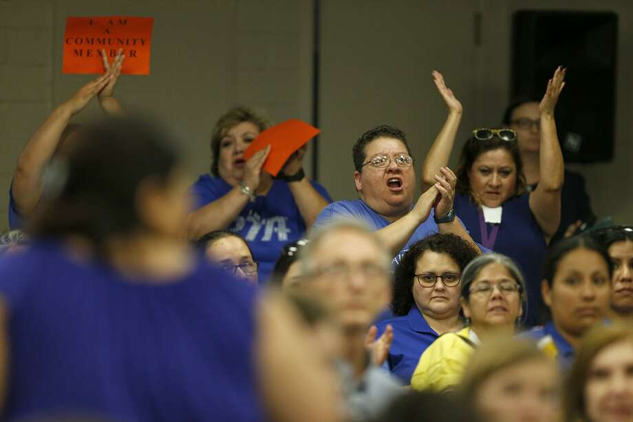Members of the San Antonio Association of Teachers and Support Personnel and other cheer for a speaker during the meeting at the district's Burnet Center. During the meeting, some laid-off teachers accused the district of cutting positions in a way that allowed for favoritism and targeting. Photo: Edward A. Ornelas /San Antonio Express-News / © 2018 San Antonio Express-News
