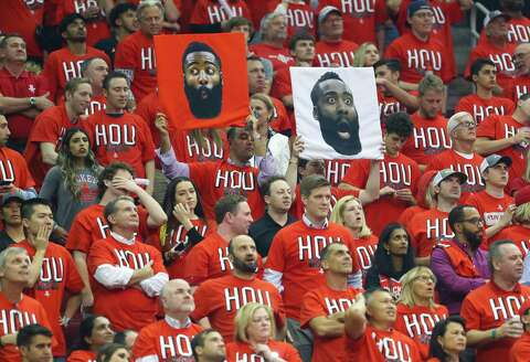 41e19a139fd Fans hold signs of James Harden during the first half in Game 1 of the NBA