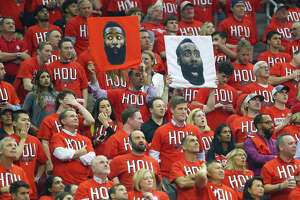 Fans hold signs of James Harden during the first half in Game 1 of the NBA Western Conference Finals at Toyota Center on Monday, May 14, 2018, in Houston.