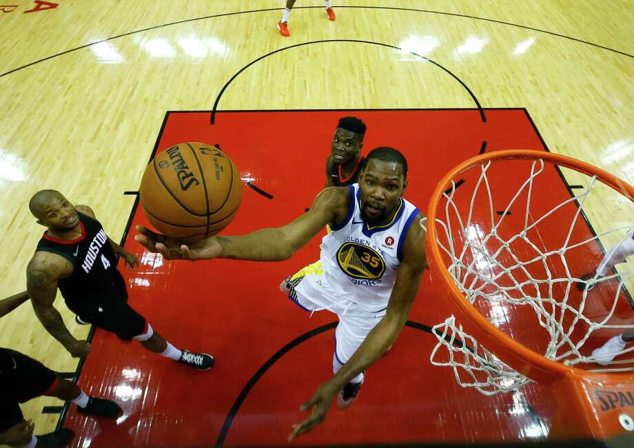 Kevin Durant often had his way with the Rockets' defense during the Warriors' Game 1 win Monday at Toyota Center. Photo: Brett Coomer, Houston Chronicle / © 2018 Houston Chronicle
