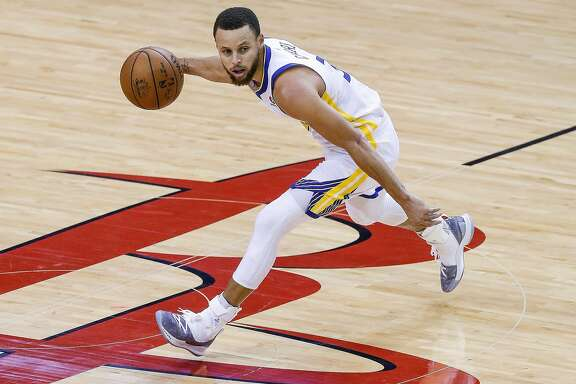 Golden State Warriors guard Stephen Curry (30) dribbles down the court during the first half of Game 1 of the Western Conference Finals at the Toyota Center Monday, May 14, 2018 in Houston. (Michael Ciaglo / Houston Chronicle)