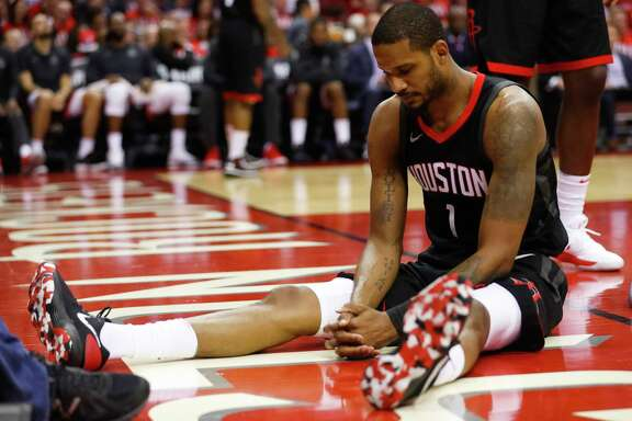 Houston Rockets forward Trevor Ariza (1) sits on the floor after a play during the second half in Game 1 of the NBA Western Conference Finals at Toyota Center on Monday, May 14, 2018, in Houston.