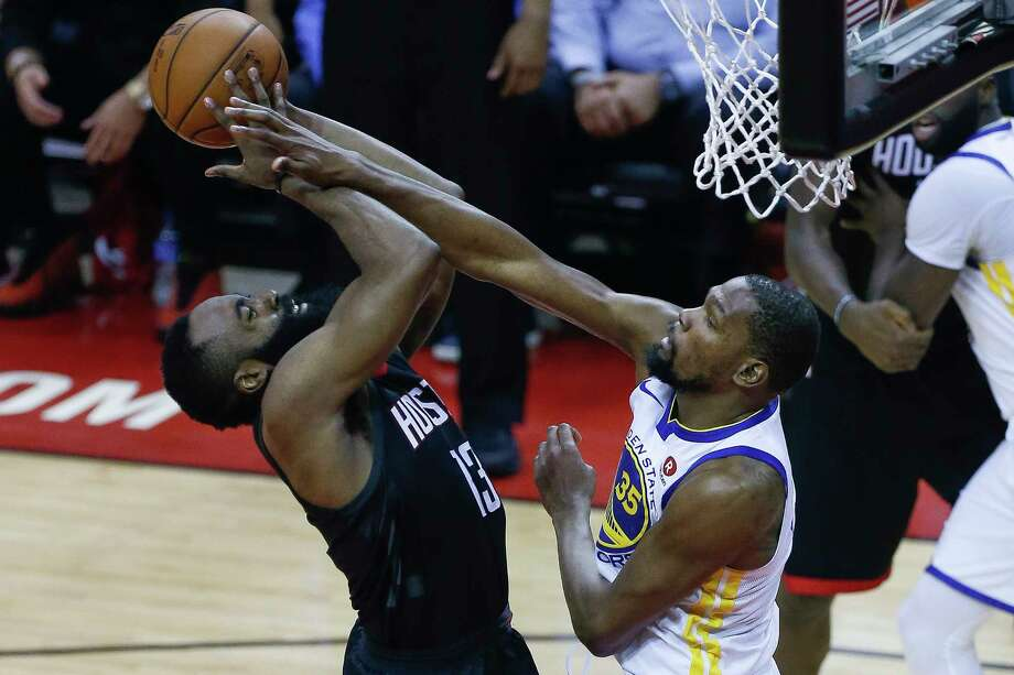 Golden State Warriors forward Kevin Durant (35) fouls Houston Rockets guard James Harden (13) during the second half of Game 1 of the Western Conference Finals at the Toyota Center Monday, May 14, 2018 in Houston. Photo: Michael Ciaglo, Houston Chronicle / Michael Ciaglo