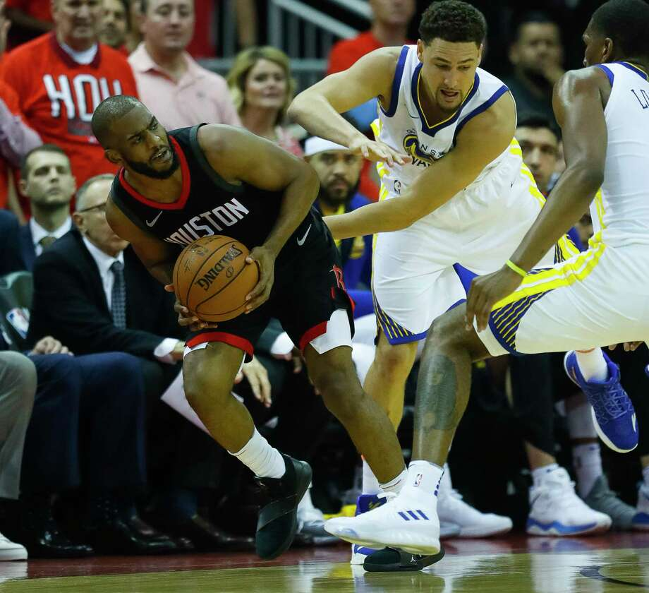Chris Paul and the Rockets are facing their first series deficit of the postseason after Klay Thompson (center) and the Warriors took Game 1 of the Western Conference finals Monday night at Toyota Center. Photo: Brett Coomer, Houston Chronicle / © 2018 Houston Chronicle