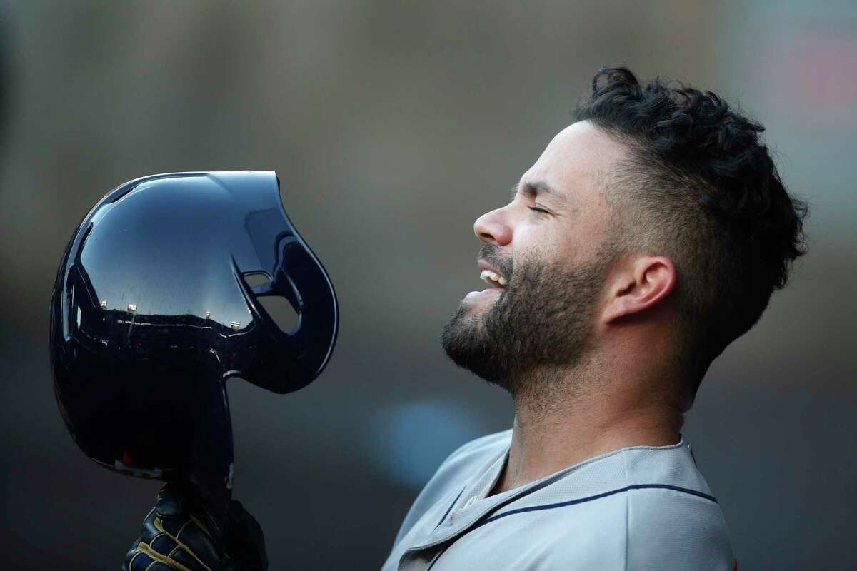 Houston Astros' Jose Altuve sings in the dugout before the team's baseball game with the Los Angeles Angels, Monday, May 14, 2018, in Anaheim, Calif. (AP Photo/Jae C. Hong)
