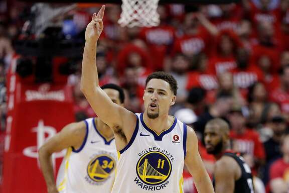 Klay Thompson (11) reacts after hitting a three-pointer in the second half as the Golden State Warriors played the Houston Rockets in Game 1 of the Western Conference Finals at Toyota Center in Houston, Texas., on Monday, May 14, 2018.